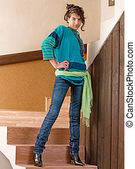 Young teenager - Pretty young teenager girl posing on stairs...