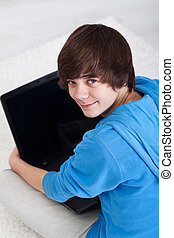 Young teenager with laptop
