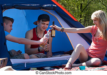 Young teenagers drinking some alcohol - Young teenage group...