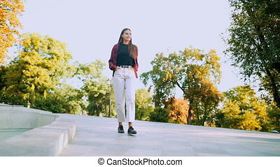Young teenager's full-length portrait. Girl in red plaid ...