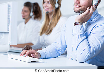 Young telemarketers in the office