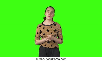 Video of young telling something woman on green isolated background
