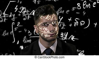 Young thoughtful attractive mathematician dressed in suit...