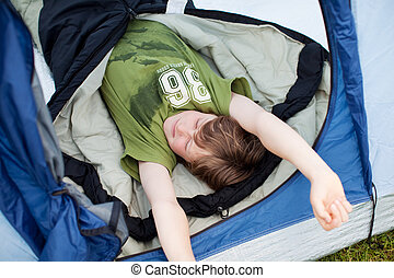 Young Tired Boy Sleeping In Tent