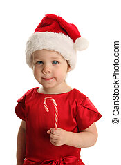 Young toddler girl with a Christmas candy cane