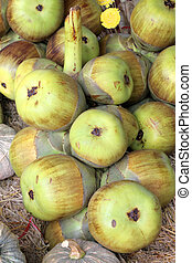 Young toddy palm fruits at local market - Young toddy palm...
