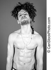 Young topless man studio portrait
