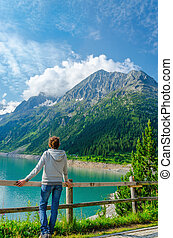 Young tourist azure mountain lake in Alps, Austria