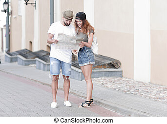 Young tourist couple with map looking for a way