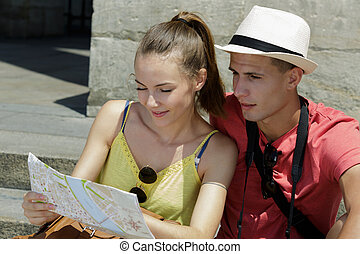 young tourist looking at the map