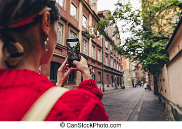 Young tourist taking photo