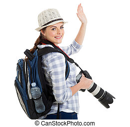 young tourist waving good bye