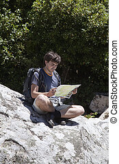 Young tourist with a map