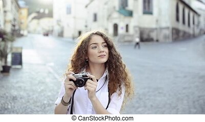 Young tourist with camera in the old town - Beautiful young...