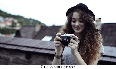 Young tourist with camera in the old town. - Beautiful young...