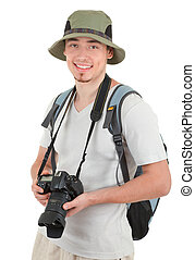young tourist with camera - young man tourist with camera on...