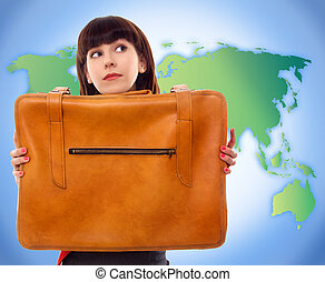 young tourist woman with baggage on world map background