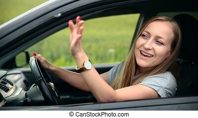 Young tourist woman with car asking for direction
