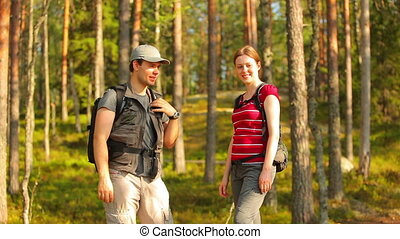 Young tourists in forest.