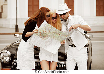 Young tourists with a road map