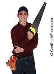 Young tradesman holding a saw