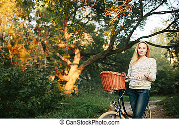 Young Tranquil woman on a Vintage Bicycle