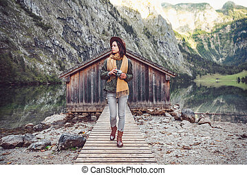 Young traveler with a retro camera in Obersee