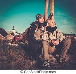 Young travelers couple in Reine village, Norway
