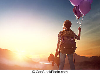 Young traveller with backpack - Little child is looking at...