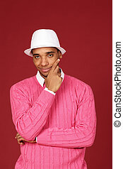 Young trendy african-american man on red background