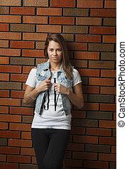 Young twentie year old woman - twenty something girl leaning...