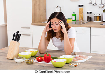 Unhappy Woman In Kitchen