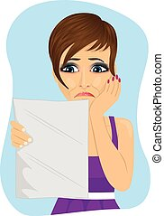 young unhappy woman reading a letter with bad news