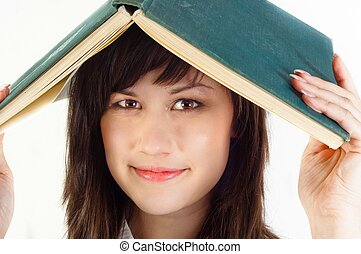 Young university student with a book on her her against white isolated background