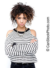 young upset african american woman with crossed arms looking at camera isolated on white