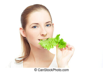Portrait of young cheerful woman with lettuce leaf