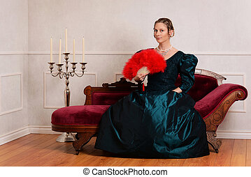 young victorian woman with red fan