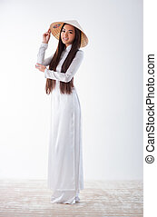 Young vietnamese woman in traditional clothing.