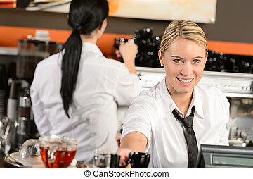 Young waitress cashier giving coffee in cafe - Young happy...