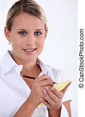 Young waitress taking an order