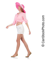 Young walking model in panama hat isolated on white