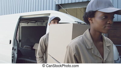 Young warehouse workers with a delivery