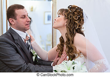 Young wedding Caucasian Russian couple wanted to kissing