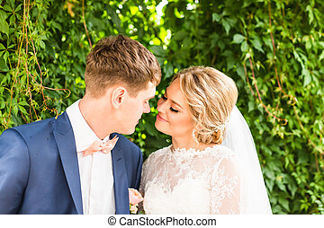 Young wedding couple enjoying romantic moments outdoors