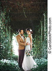 Young wedding couple enjoying romantic moments outside