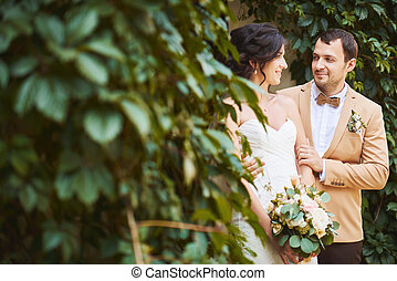 Young wedding couple enjoying romantic moments outside