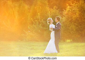 Young wedding couple on summer meadow - Young wedding couple...
