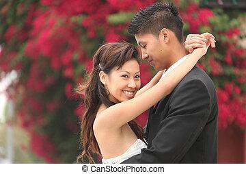 Young Wedding Couple Outdoors - Asian American Wedding...