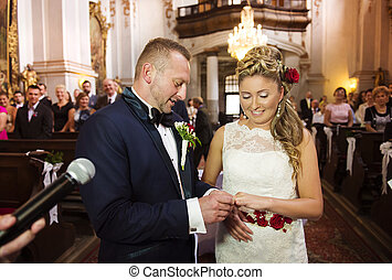 Young wedding couple - Bride and groom in the church...