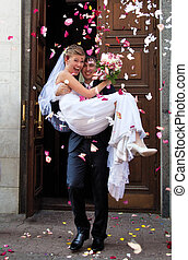 Young wedding couple. Traditional coming out after marriage registration.